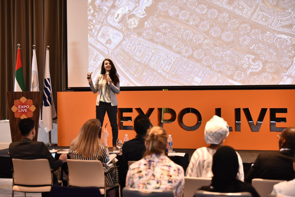 Humans in the Loop CEO and founder Iva Gumnishka pitch at Expo Live Dubai UAE with annotation background