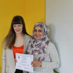 A teacher and a student pose together after an upskilling graduation with certificate